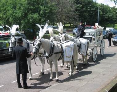 Horse drawn hearse outside aston parish church